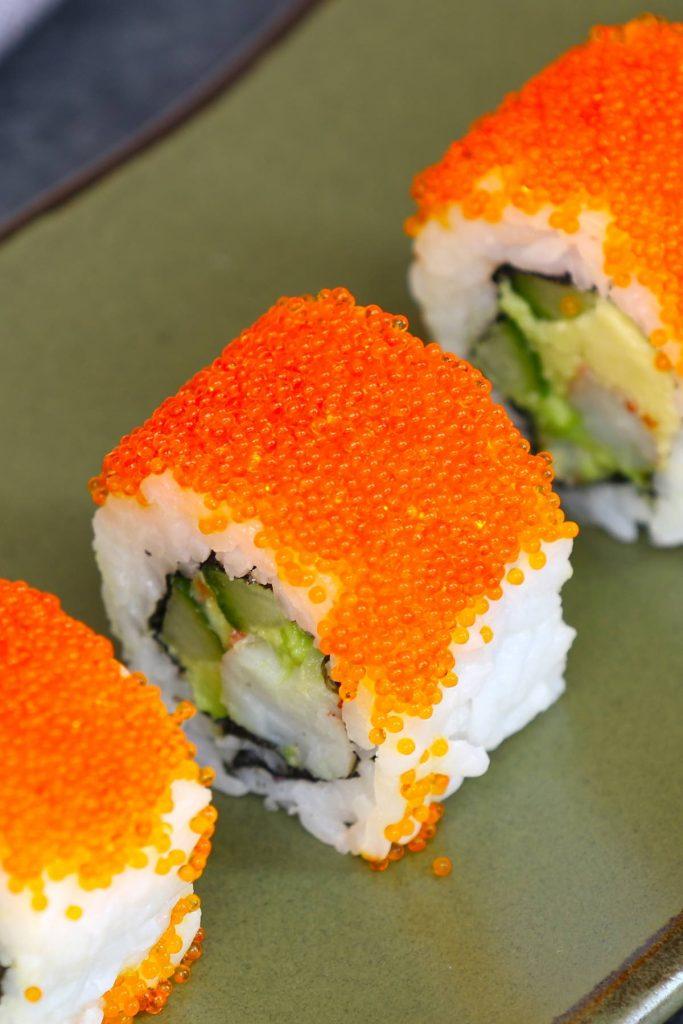 Tobiko is the Japanese word for flying fish roe, which is crunchy and salty with a hint of smoke. It's a popular ingredient in Japanese cuisine as a garnish to sushi rolls. #tobiko #TobikoSushiRoll