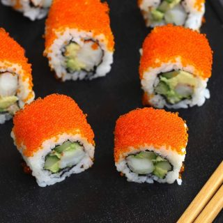 Tobiko Sushi Roll is made with delicious shrimp, creamy avocado and crunchy cucumber rolled in seaweed sheet and sushi rice, with a tobiko topping. It's so easy to make and I'll share with you how to make perfect tobiko sushi.