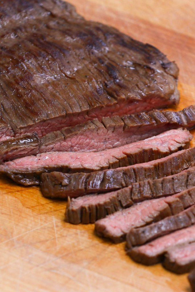 This Balsamic Marinated Sous Vide Flank Steak is melt-in-your-mouth tender and juicy. The balsamic, honey, and soy sauce based marinade makes this cut extra flavorful, and the sous vide method allows you to cook it to perfection – turning this cheap cut better than your favorite steakhouse! #SousVideFlankSteak #SousVideSteak #SousVideSteakMarinade