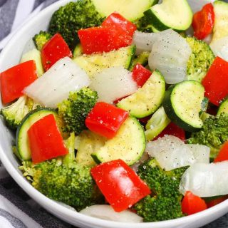 Sous Vide Mixed Vegetables are my favorite side dish. It's the easiest way to make perfect veggies. Here is a how-to guide for making healthy and delicious sous vide vegetables with a variety of veggies including broccoli, zucchini, bell pepper, and onions.