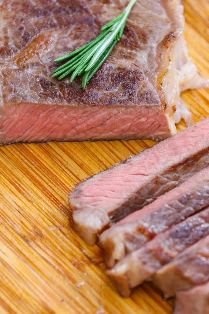 Sous Vide New York Strip Steak is my favorite steak recipe. All you need is a few very simple ingredients to bring out the best flavor of this popular cut. The sous vide method cooks it perfectly edge to edge, producing a better-than-restaurant quality right at your own home! #SousVideNewYorkStrip #SousVideNYStrip #SousVideSteak