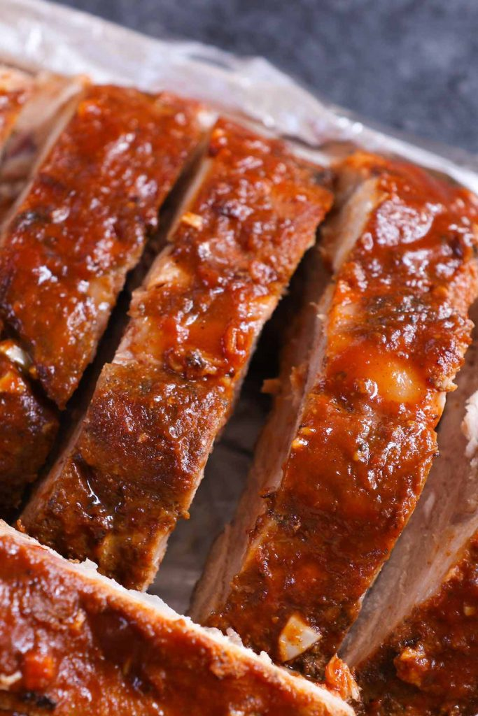 Sous Vide Barbecue Ribs are the most tender and juicy ribs ever! Cooked low and slow to the perfection in the sous vide water bath with a homemade spice rub, then finished on the grill or in the oven with a seasoned BBQ sauce mixture that's so addictive. Finger licking delicious ribs right here! #SousVideRibs #SousVideBarbecueRibs #SousVideBabyBackRibs