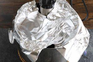 Covering the sous vide water bath with alumnimum foil.