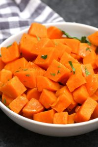Sous Vide Sweet Potatoes are the most delicious and nutritious veggie ever! They're fluffy, sweet and come out perfectly EVERY TIME! This simple side dish recipe takes a few minutes to prepare, then the sous vide machine will do the rest of the work and cook the sweet potatoes to perfection. #SousVideSweetPotatoes