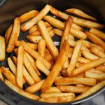 This is the BEST way to cook frozen French fries in the Air Fryer! It's so perfectly golden and crisp on the outside and fluffy and tender inside. Dip into your favorite sauce and the result is always amazing!