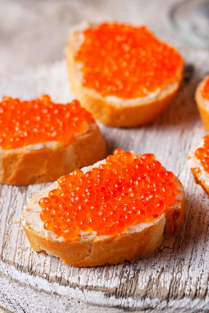 Salmon caviar served on toasts.