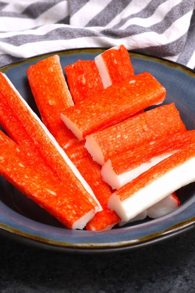 Kanikama is the Japanese name for imitation crab, which is processed fish meat, and sometimes called crab sticks or ocean sticks. It's a popular ingredient commonly found in California Sushi Rolls, crab cakes, and crab rangoons. #Kanikama #ImitationCrab #ImitationCrabMeat #imitationCrabRecipes