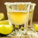 Lemon drop shots are one of my favorite shots when I'm out and about. It's sweet and tart with lots of lemony flavors. After years of ordering it at bars, I finally decided it's time to learn how to make a great lemon drop shot recipe at home. #LemonDropShot #LemonDrop #LemonDropShotRecipe