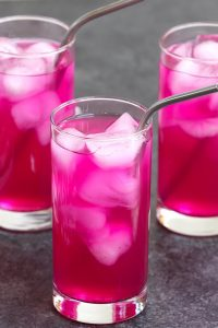 This Mango Dragonfruit Refresher brings your favorite coffee shop drink home! The Starbucks dragon drink copycat recipe gives you all the amazing flavor and beautiful pink color of the store-bought drink at the fraction of the price. It's a perfectly refreshing fruity drink that takes less than 5 minutes to make with a few ingredients. It's incredibly delicious with or without coconut milk! #MangoDragonfruit #MangoDragonfruitRefresher #StarbucksDragonDrink #Dragondrink