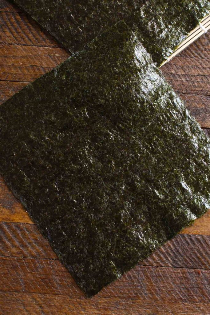 A piece of nori sheet on the counter.