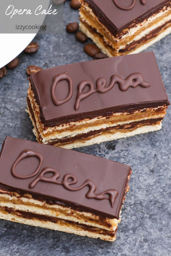 Opera Cake is a classic French dessert combining layers of almond sponge cake soaked in coffee syrup, espresso-flavored buttercream, and decadent chocolate ganache. It's finished with a smooth chocolate glaze. This recipe has been tested many times and is easily the best homemade opera cake recipe that I've ever tried. #OperaCake #OperaCakeRecipe