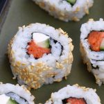 Philadelphia Rolls are filled with smoked salmon, cream cheese and cucumber, then rolled in nori seaweed sheet and sushi rice. In this recipe, you will learn how to make sushi rice, how to roll the the sushi, and how to make the delicious and creamy Philly roll. #PhiladelphiaRoll #PhillyRoll #SmokedSalmonSushi #PhillyRollSushi
