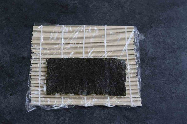 Flip the nori sheet and let the rice face down.
