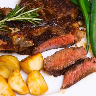 These Sous Vide Ribeye Steaks are cooked in a warm water bath to perfection and then butter-basted quickly in the skillet for a beautiful and flavorful brown crust. It's so tender, juicy and really simple to make at home. It will remind you of those at your favorite steak house.