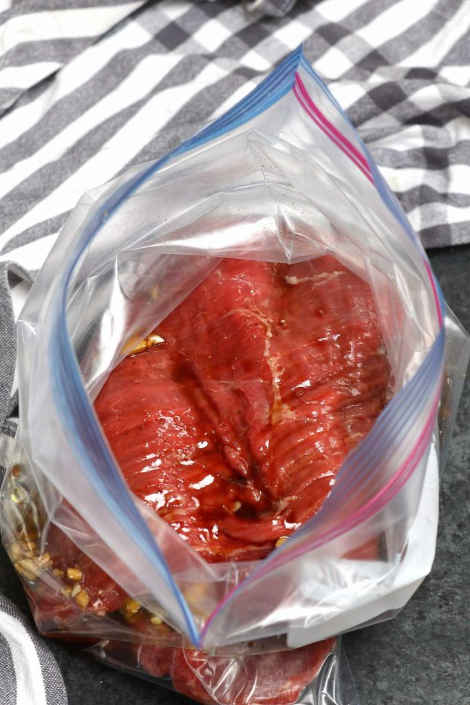 Steak and the marinade in a zip-top bag.