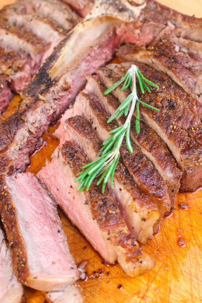 Perfectly tender and juicy t-bone steak cut away from the bone.