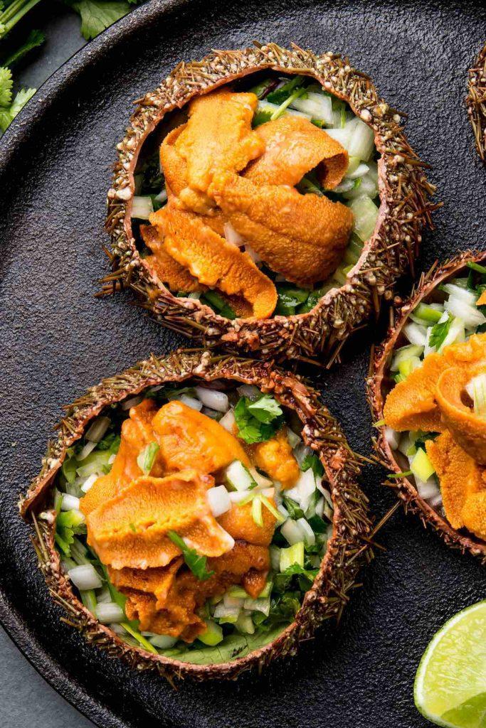 Uni salad served inside of sea urchin shells.