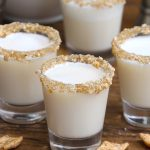 Cinnamon Toast Crunch Shotis an adult version of your favorite childhood cereal, in shot form. The base of this delicious alcoholic drink is RumChata and Fireball Whiskey, served in shot glasses rimmed with crushed cinnamon toast cereal. Sweet, boozy, and creamy with a nice cinnamon flavor! #CinnamonToastCrunchShot #CinnamonToastShot #RumChataShot