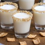 Cinnamon Toast Crunch Shot is an adult version of your favorite childhood cereal, in shot form. The base of this delicious drink is RumChata and Fireball Whiskey, then rimmed with crushed cinnamon toast cereal.