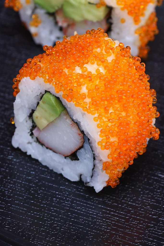 Masago is the roe of capelin, a fish in the smelt family. It's a popular ingredient in Japanese cuisine because of its distinct taste. Masago eggs are very small, and often used as a topping in a variety of sushi recipes. In this post you'll learn everything about masago and how to make masago sushi rolls. #masago #MasagoSushi