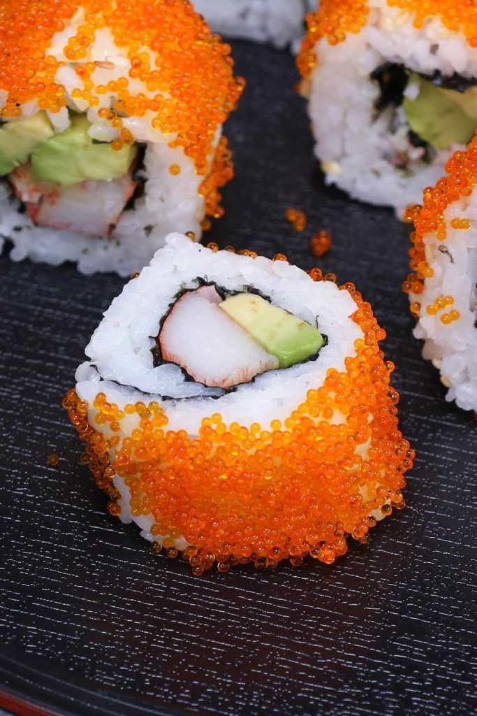 California roll sushi with a masago topping.