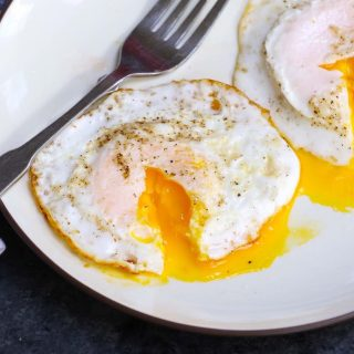 Over-medium eggs are a beautiful thing. The whites are just firm enough on the outside to hold a slightly runny, golden yolk that oozes deliciousness. And with a few tips, you too can learn how to fry an over-medium egg perfectly every time! It takes only 5 minutes and it's so easy to make!