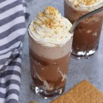 Bring your favorite coffee shop drink home! This copycat Starbucks S'mores Frappuccino is creamy, chocolatey, and full of marshmallow, coffee, and graham crackers flavor. Made with a few simple ingredients, it gives you all the summer refreshing taste of the Starbucks Campfire Smores Frap at the fraction of the price! #SmoresFrap #StarbucksSmoresFrap #SmoresFrappuccino