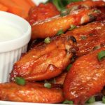 You'll be amazed at just how perfect Sous Vide Chicken Wings are! It eliminates the mess and oil of deep fried chicken wings while creating the delicious game day snack! Cooking them sous vide means these Buffalo chicken wings come out perfectly tender, juicy, and are loaded with flavor. #SousVideChickenWings