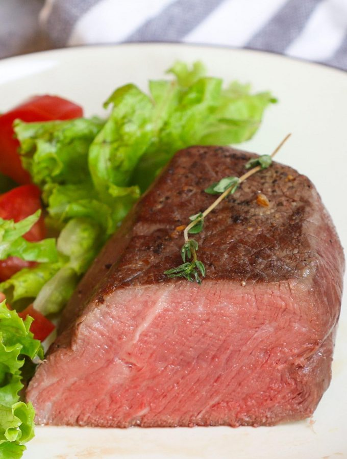 Learn how to make the perfect sous vide filet mignon – cooked in a warm water bath at the precise temperature and finished with a quick sear in a hot skillet. This sous vide beef tenderloin steak is super tender, juicy, and full of flavor! With a temperature and time chart for different doneness including rare, medium-rare, medium, and well-done. #SousVideFiletMignon