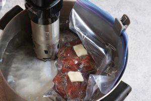 Cooking the steak in a sous vide water bath.