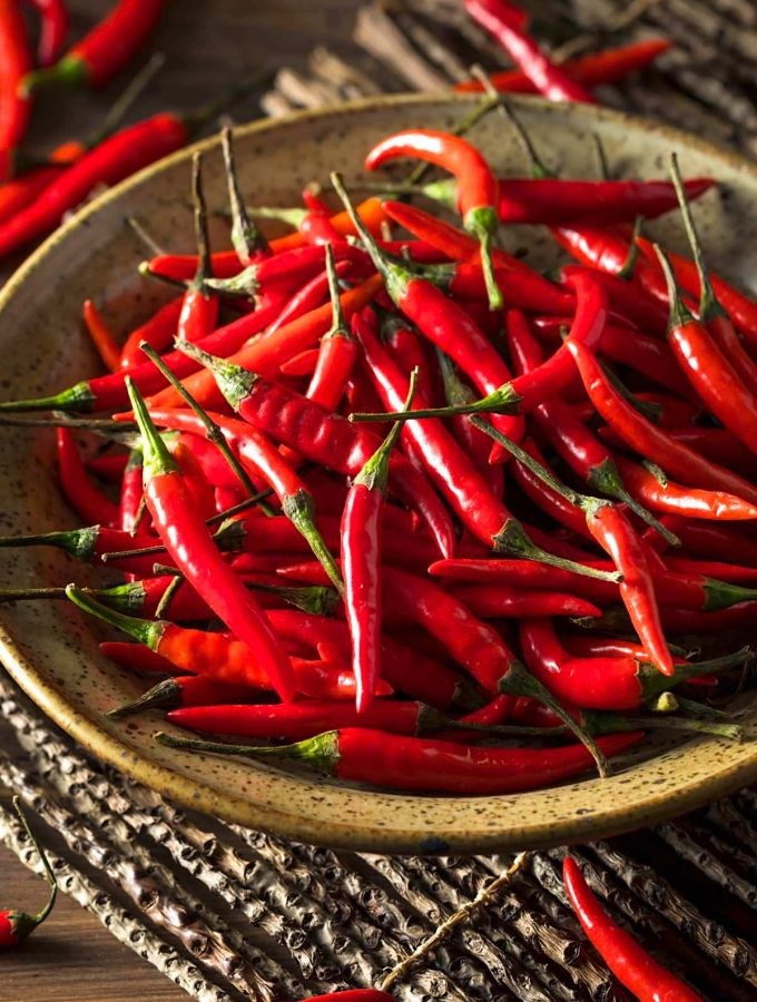 Thai peppers are spicy chili peppers that are used in many cuisines as a way to add heat to dishes. There are so many types of Thai chili peppers: some are mild; others are extremely hot. Let's find out everything about Thai chili from types, heat level, usage, substitute, and more! #ThaiPepper #ThaiChili #ThaiChiliPepper