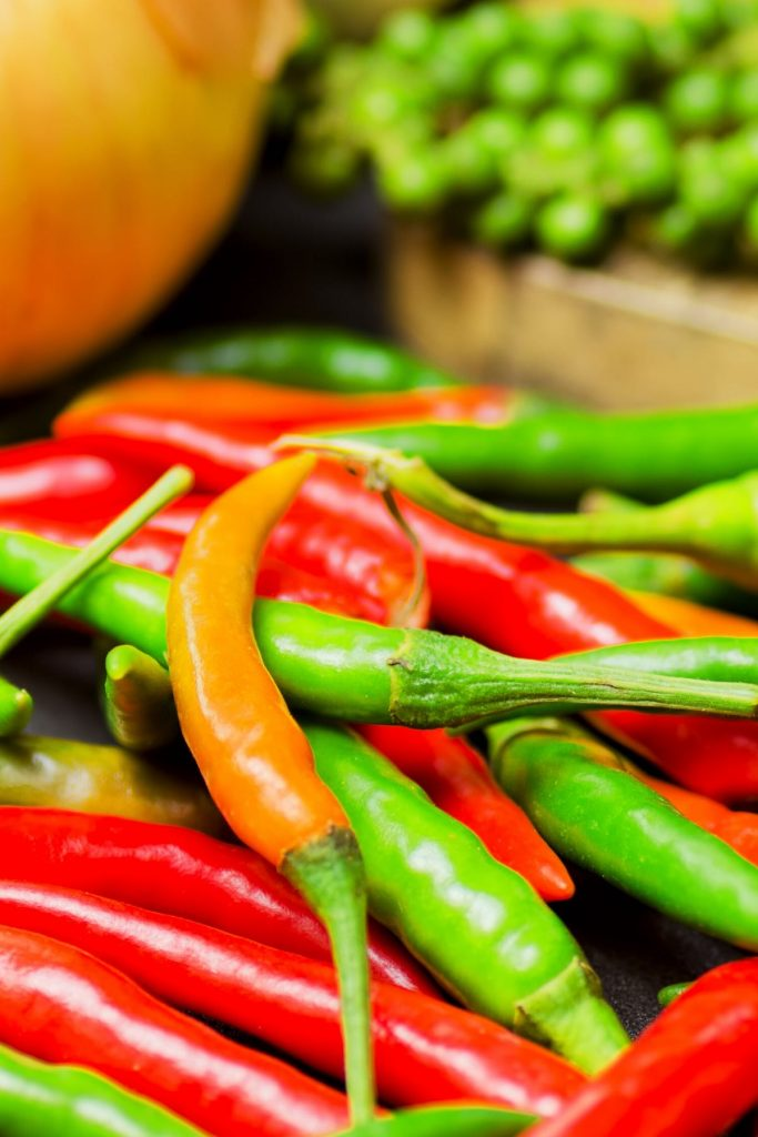 Thai peppers are spicy chili peppers that are used in many cuisines as a way to add heat to dishes. There are so many types of Thai chili peppers: some are mild; others are extremely hot. Learn how to use them, different types, heat levels, substitute, and more! #ThaiPepper #ThaiChili #ThaiChiliPepper