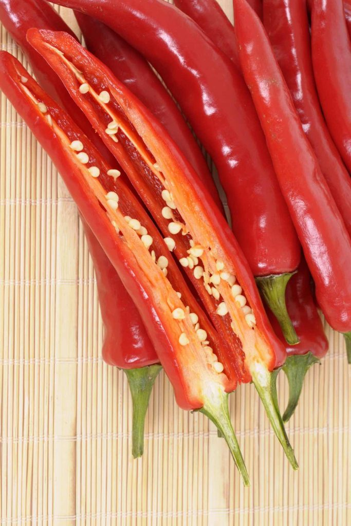 Thai peppers are spicy chili peppers that are used in many cuisines as a way to add heat to dishes. There are many types of Thai chili peppers: some are mild; others are extremely hot. Learn how to use them, different types, heat levels, substitute, and more! #ThaiPepper #ThaiChili #ThaiChiliPepper