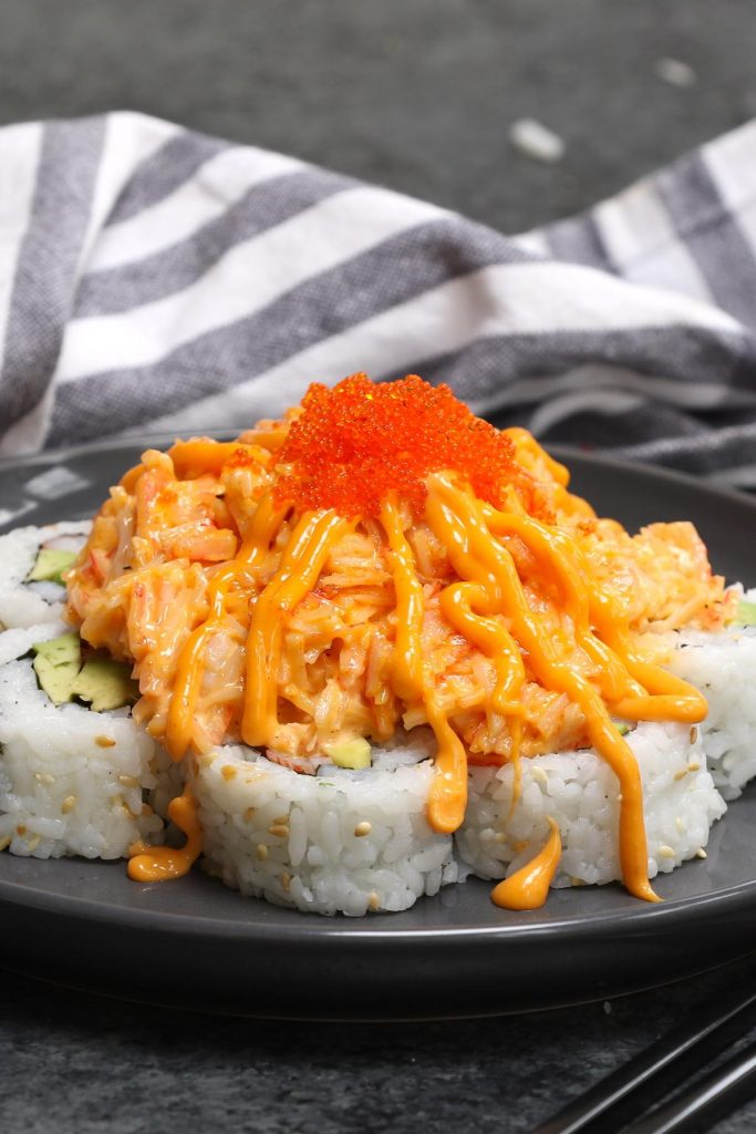 The Volcano Roll is highly addictive and will definitely blow your mind! It's made with seafood, avocado, and cucumber rolled in seaweed sheet and sushi rice, with an incredibly delicious spicy lava topping. This recipe is easy to make and I'll share with you the secrets on how to make a mouth-watering crab salad lava topping! #VolcanoRoll #VolcanoRollSushi