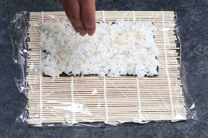 Sprinkle sesame seeds on top of the rice.