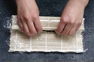 Rolling the sushi and press tightly.