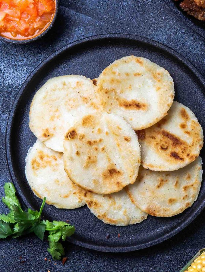 Homemade Arepa Paisa is so soft and fluffy – a delicious Colombian breakfast dish. It's a popular flatbread made of corn, and can served on its own or topped with eggs, cheese or meat!