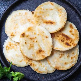 Homemade Arepa Paisa is so soft and fluffy – a delicious Colombian breakfast dish. It's a popular flatbread made of corn, and can be served on its own or topped with eggs, cheese or meat!