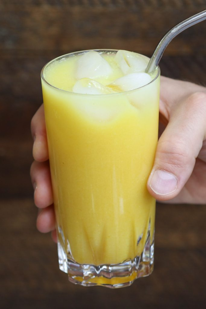 Make a delicious and beautiful Starbucks Iced Golden Ginger Drink at home! Keep this dairy-free beverage healthy by using the healthy ingredients and save money. This DIY copycat yellow ginger drink has the perfect blend of coconut milk, ginger, pineapple, and turmeric flavor. It's an amazing refreshing fruity drink that takes less than 5 minutes to make. #IcedGoldenGingerDrinkStarbucks #GoldenGinger #StarbucksGoldenGingerDrink #StarbucksYellowDrink