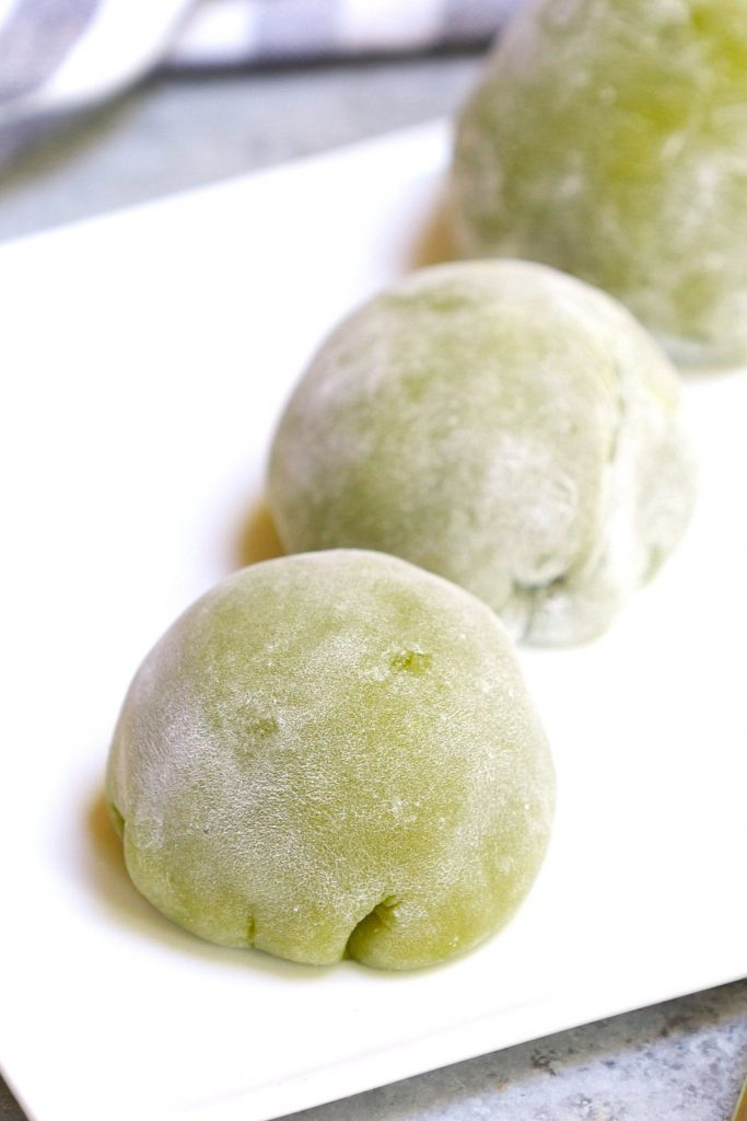 Homemade Green Tea Mochi is soft, chewy, and sweet with delicious matcha flavor and a beautiful green color. This classic Japanese treat is really easy to make at home and better than that from your favorite restaurant! Plus you can customize the filling with red bean paste, strawberry, or ice cream. #GreenTeaMochi #MatchaMochi