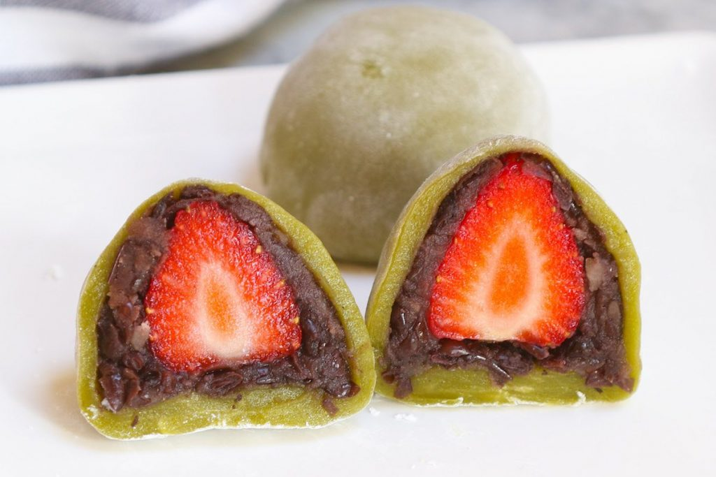 Green tea mochi stuffed with anko red bean paste and strawberries.