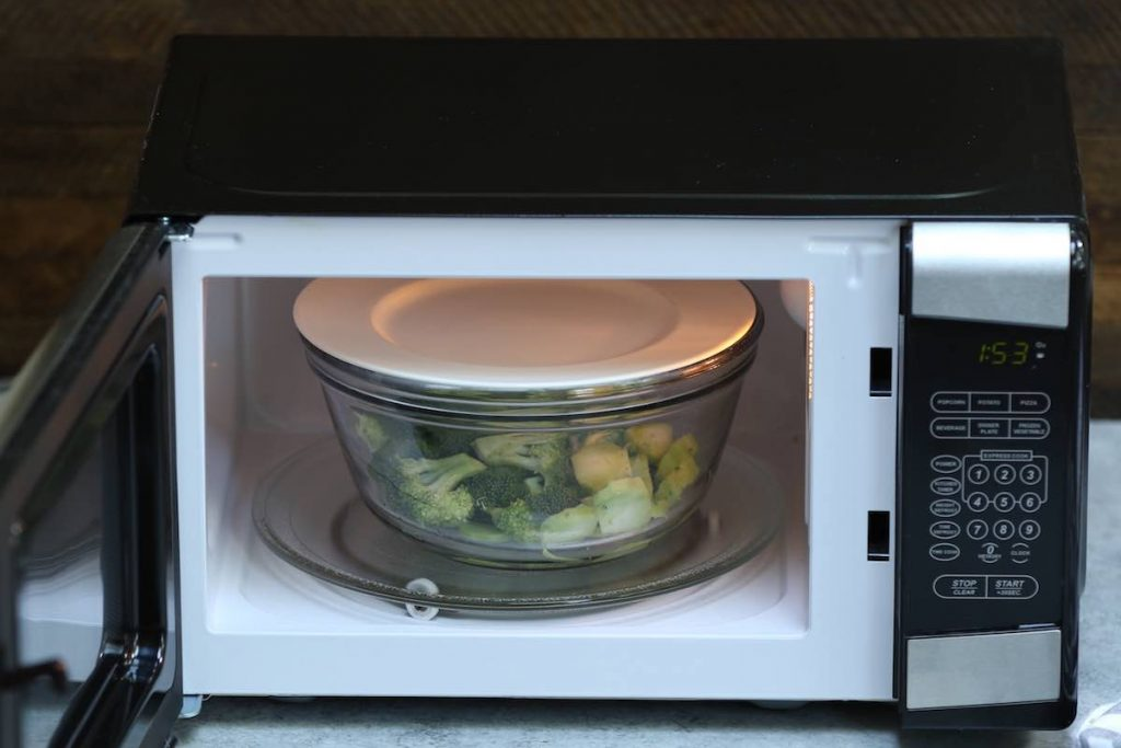 Cover the bowl with a ceramic plate, and place it in the microwave.