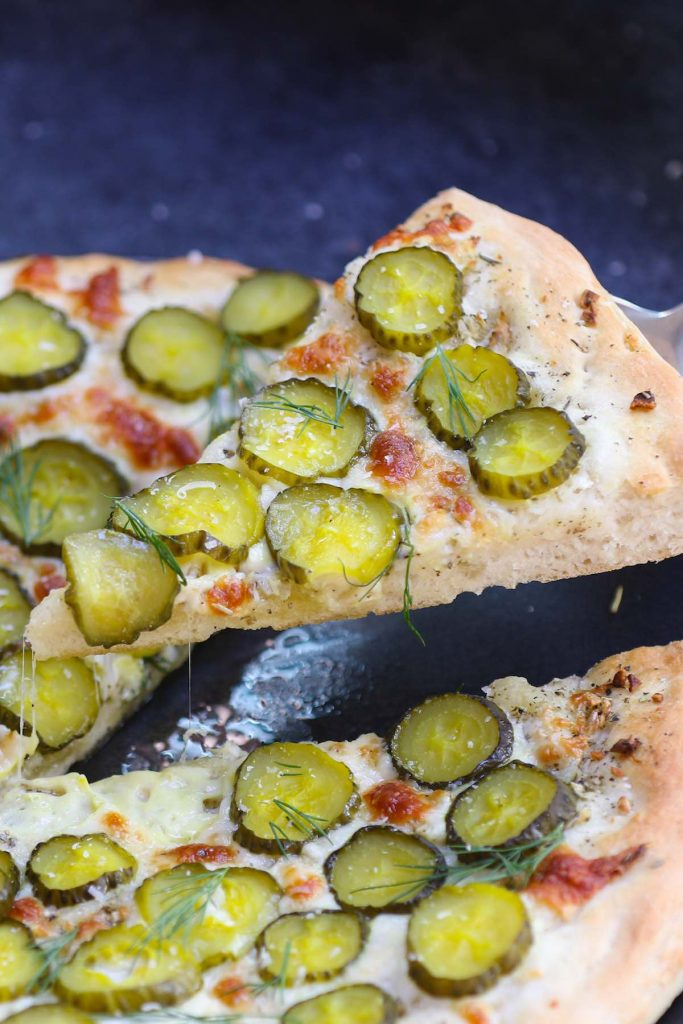 Freshly baked pickle pizza.