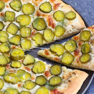 Pickles on Pizza! I never thought I'd like the idea, then once upon a time I tried Dill Pickle Pizza with garlic sauce. It changed my entire outlook on pickle pizza. The combination of cheesy, garlicky, and tangy flavors is seriously good! And there's ranch on the side for dipping.