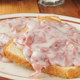 Shit On A Shingle is the ultimate comfort meal that's fast and inexpensive. My mom used to make this for a quick breakfast, lunch or light dinner. Also called SOS, it's a classic American military dish made with creamed chipped beef, and served over toast. This is a healthier version with lighter creamy white sauce. #ShitOnAShingle #ChippedBeef #CreamedChippedBeef
