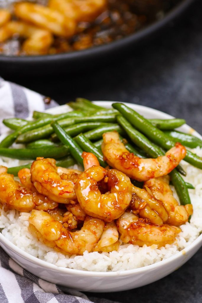 Sous Vide Shrimp Recipe makes the most tender and juicy shrimp that's impossible to achieve with traditional methods. Ready in 20 minutes, this healthy dinner is so flavorful and lip-smacking delicious with the addictive honey garlic sauce. No more overcooked and chewy shrimp again. You can cook the shrimp from fresh or frozen! #SousVideShrimp