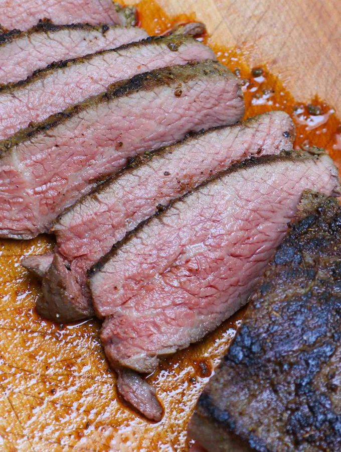 Santa Maria Style Sous Vide Tri Tip nails the edge-to-edge perfection on this triangle shaped bottom sirloin cut, resulting in amazingly juicy and tender steak. The tri-tip roast is cooked low and slow in a sous vide water bath, and then seared quickly in the skillet for a peppery, garlic-y brown crust. #SousVideTriTip #TriTipSouVide