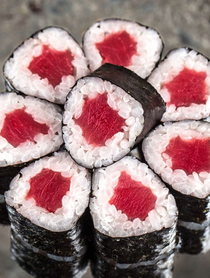 Tekkamaki Tuna Rolls are made with sashimi grade tuna rolled in vinegared sushi rice and nori seaweed sheet. Homemade Tekka Maki is so much cheaper than the restaurant, and it takes about 15 minutes from start to finish.#TekkaMaki #TunaRoll
