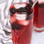 Make a delicious Very Berry Hibiscus Refresher at home! This Starbucks copycat recipe gives you all the refreshing flavor and beautiful color of the store-bought iced beverage at the fraction of the price. It's incredibly easy to make the tea-based drink and you can easily customize by adding lemonade or coconut milk! #VeryBerryHibisucs #VeryBerryHibiscusRefresher