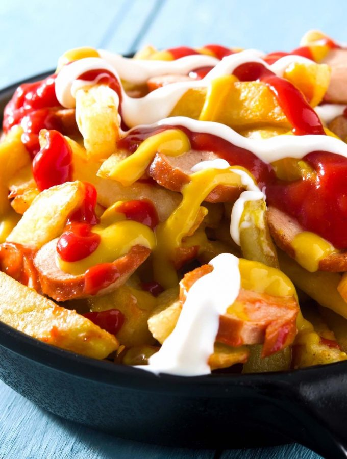 Salchipapas is a local Peruvian street food. But you can easily make it at home with homemade French fries and pan-fried hot dogs. This fast food is perfect for parties, game days, or other special occasions when you crave a tasty and comfort appetizer or meal. #Salchipapa #Salchipapas